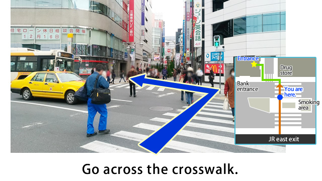 Go across the crosswalk on the left.